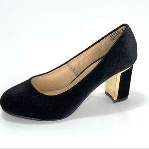 Not Rated Black and Gold trimmed pumps